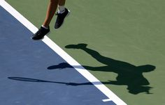 Caroline Wozniacki, of Denmark, casts a shadow as she serves to Ying-Ying Duan, of China, during the first round of the 2013 U.S. Open tennis tournament Tuesday, Aug. 27, 2013, in New York. (AP Photo/Mike Groll)