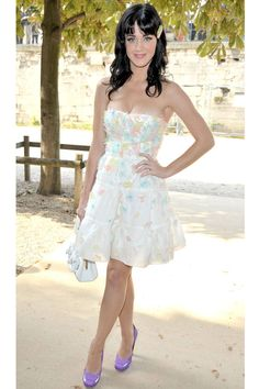 At the Christian Dior spring/summer 2008 show, Perry spices up her pastel dress by adding purple platforms.   - ELLE.com