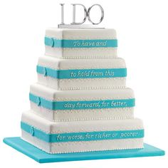 A Future Promise Cake - Wedding vows take on a special meaning when they're displayed on this elegant cake. Topped with the I DO Cake Pick and finished with decorative icing scrollwork, this cake is an enchanting addition to any wedding celebration.