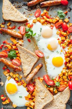 Sheet Pan Full Breakfast with fried eggs, sweet potato hash brown, breakfast sausages, and toast  | Imagelicious