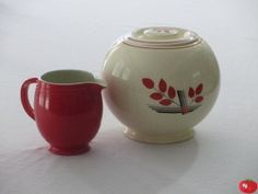 Here is my Kitchen Kraft Covered Jar made by The Homer Laughlin China Company.  I found this recently for a great price and it is in perfect condition.  The covered jar was made in three different sizes. Mine has an Art Deco leaf pattern, but they also came in solid colors in red, cobalt, green and yellow.  Production began in 1937 and ended in 1944.  The solid colors are hard to find and are pretty expensive.