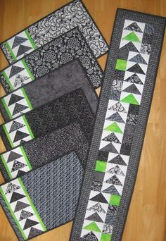 Geese Across the Table - placemats and matching runner. Flying geese and bright accents. Pattern on Craftsy - smaller for mug rugs? Patchwork Table Runner, Table Runner And Placemats, Table Runner Pattern, Quilted Table Runners, Quilt Placemats, Small Quilts, Mini Quilts, Quilting Projects, Sewing Projects