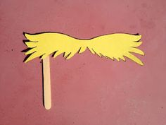 the Lorax mustache on a stick! Fun for classroom photos :)