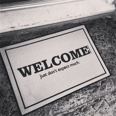 """Welcome Just Don't Expect Much Doormat / This """"Welcome Just Don't Expect Much"""" Doormat from High Cotton is a great way to make guests feel welcome while tamping down their expectations. http://thegadgetflow.com/portfolio/welcome-just-dont-expect-much-doormat/"""