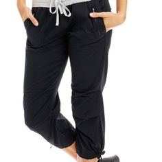 NWT Lorna Jane Flashdance 3/4 pant Slimmer fitting, this 3/4 pant is a variation of the popular Flashdance pant.  Made from lightweight LJ stretch woven cotton poplin fabric, designed to move with you.  Gathered cotton/elastane jersey waistband and external draw cord.  Leg length finished at mid calf with a drawstring hem. Lorna Jane Pants Capris