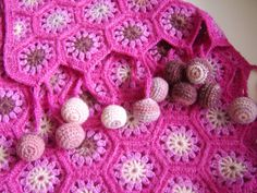 Crocheted Hexagon Baby Blanket  I wonder if I could make this.. WITHOUT the balls on the ends... not to thrilled with those...