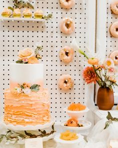 Dessert Table Dreams! Cakes. Donuts. Cupcakes. Candy.  Our large white donut wall with drawers and shelves paired with white table top decor is perfect to show off all the fun desserts for your guests! . Image shared from our Just Peachy inspiration: Photography & co planning @kristisneddon  Planning/design/rentals @orangetrunk  Venue @sweethavenbarn  Stationery @thesocialpage  Gown @lovenotebride  Suit @ewmenswear  HMUA @hairandmakeupbyrobin_ @avebeauty  Florals @foxtailfloraldesigns… White Table Top, Just Peachy, Large White, Image Sharing, Dessert Table, Fun Desserts, Vintage Furniture, Donuts, Florals