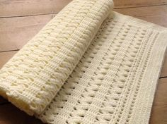 This exquisite zigzag shell and lace blanket is perfect for a new baby. The pattern looks complicated but is actually just a series of 3 panels of zigzag shells attached with a lace design and then a simple border to complement.This is perfect for anyone wanting to make a traditional style blanket but without the frills.The blanket is worked in soft 4ply baby wool and is a great size to use as a wrap or shawl or a pram cover. This would make a wonderful gift for a newborn or perfect as part…