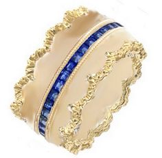 Two gold scalloped bands surrounding a blue sapphire eternity band all stacked together. #ashleymorgandesigns #sanfrancisco #jewelry #designer #bridaljewelry #engagementring #sapphires #diamonds #ring #gold