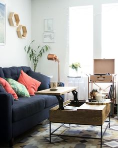 Room Tour: A Millennial's Living Room Grows Up! A Boston blogger parts ways with her mismatched hand-me-downs in favor of more adult pieces. That meant replacing such items as the hideous '80s floral sofa she got from a friend's parents, and swapping it for more mature, quality pieces.