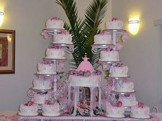 8 in. cakes sit around the fountain base.  With doll cake as topper.