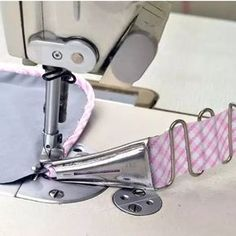 Bias Tape Maker PackThanks schuesslerjana for this post.Easily make your own bias tape for binding. Cut a bias strip of fabric and slip though the wider end of the bias tape maker. Pull the handle as you press. It's that simple. Edges are alw# Bias Sewing Tools, Sewing Hacks, Sewing Tutorials, Dress Tutorials, Techniques Couture, Sewing Techniques, Formation Couture, Bias Tape Maker, Sewing Machine Parts