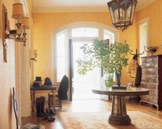 15 Tips For Entryway Organization: Entryways are quick to become cluttered, but a few extra hooks and an extra piece of furniture can turn a messy foyer into a functional, stylish room.