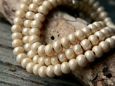 6/0 Lustered Buttermilk Seed Beads by BeadsandmorebyYashma on Etsy