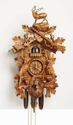 "Model #8TMT 295G-H/7 Musical Hunters Cuckoo Clock with Live Animals and Full Stag     •Hunters cuckoo clock with live animals (upright)   •29.5"" H x 17.3"" W   •German Regula, 8 day movement (must be wound weekly)   •Hand-carved cuckoo clock with stag, crossed guns, pheasant and rabbit.   •Plays 1 of 2 melodies after the call of cuckoo at the top of the hour   •Animated dancing couples"