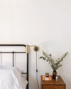 """.Gℯmary on Instagram: """"A little update on this side of our bed, sconce from my old room is finally up. // #rNgHOME"""". midcentury room, iron bed frame."""