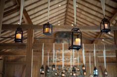 Lanterns hang from the ceiling at rustic indoor wedding reception Indoor Lanterns, Outdoor Hanging Lights, Lanterns Decor, Hanging Lanterns, Rustic Lanterns, Lantern Centerpieces, Outdoor Lighting, Red Wedding, Wedding Colors
