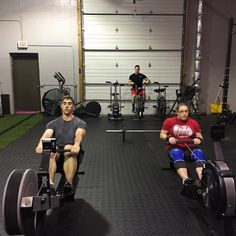 Matt and Kris getting in their 3 rounds of: Row front squats and toes-to-bar preceded by 5x10 heavy back squats.  Coach Fahdi hitting the airdyne for 200cals in the back. #fitfam #solonohio #transformation #hiit