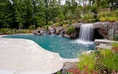 How Much Does The Swimming Pool Installation Cost? Swimming Pool Waterfall, Outdoor Swimming Pool, Swimming Pools, Rock Waterfall, Garden Waterfall, Pool Spa, Pool Installation Cost, Tropical Pool, Beautiful Pools