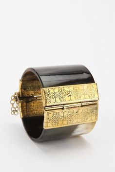 One of my favorite items in my jewelry box. Etched brass-trimmed horn cuff bracelet.  25th Floor for #UrbanOutfitters, $48.
