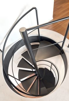 Officine Sandrini: we produce customized hanging stairs, open stairs, spiral stairs, using innovative and quality materials. Spiral Staircase Kits, Spiral Stairs Design, Home Stairs Design, Curved Staircase, Interior Stairs, Modern Staircase, Stair Handrail, Staircase Railings, Vertical Garden Design