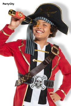 They're the captain of the high seas in this light-up pirate costume for kids. This detailed sailor costume features a top that looks like a white shirt, a black vest, and a red jacket with gold trim. The attached belt features a skull and crossbones in the center with light-up red eyes. Complete their look with black and gray striped pants and a black hat with a Jolly Roger and a striped scarf. They can grab their own cutlass and head off on adventures Pirate Costume Kids, Halloween Costumes, Black Vest, Black And Grey, Sailor Costumes, Jolly Roger, Kids Lighting, Skull And Crossbones, Red Eyes