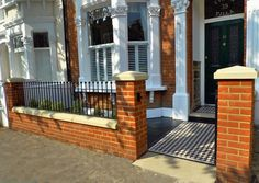 Front garden london-red-brick-wall-with-rails-and-victorian-mosaic-tile-path. Victorian Front Garden, Victorian Terrace, Edwardian House, Victorian Homes, Garden Wall Designs, Garden Design, Backyard Designs, House Design, Victorian Mosaic Tile