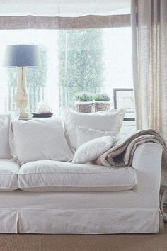 White sofa and linen curtains - living room