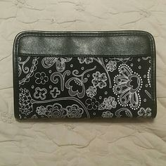 Thirtyone Was never used has a slot for pen but pen is not included snaps to close . NWOT thirty-one Bags Wallets