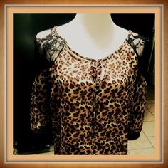 Leopard Print Top Leopard print top with black lace accents on arms.  Three quarter length, batwing sleeves with elastic at the bottom of the sleeves.  Tie bodice.  100% polyester.  Measurements laying flat. Bust 26 inches. Hips 25 inches. Length 26 inches. Length of sleeves 12 inches!  Sized 3x but please look at measurements!  Worn once Very light top! Great for spring, summer, or fall! (CB1) Tops