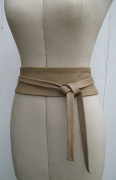 Nude leather wrap belt.