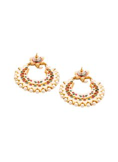 This pair of evergreen chand balis by Shillpa Purii is sure to add charm and elegance to your outfit. The earrings have a classic crescent shape and are studded with pearls and kundan stones. Vibrant green and red enamel work behind the kundan stones adds a touch of colour to the back of the earrings. The floral top and the delicate row of pearls lining the earrings give it a truly traditional appeal, making it a perfect companion for festive outfits.