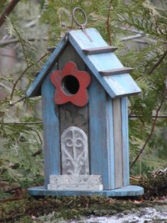 Bird house red flower will blend into a wooded environment, but will also add style to any nature setting.