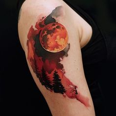 Deadly beautiful blood moon sleeve tattoo. The half ink design of the tattoo gives us a small glimpse of the blood moon and the terrifying night which is to come. It creates suspense and excitement within the design.