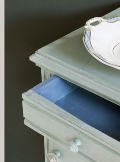 Duck Egg Blue with a Graphite wall and Greek Blue inside the cabinet drawer