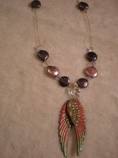 Custom piece...Angel wings coin pearls and Swarovski crystals.