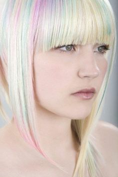 Long hairstyle with beautiful bangs and soft coloured highlights