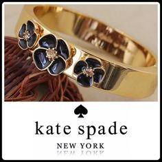 HPX2 KATE SPADE FLUTTER BANGLE Rare and hard to fine! Stunning and flirty 12kt gold plated hinged cuff bangle with black flowers. Each flower has center Swarovski crystal in the center. Will comfortably fit a wrist not larger then 7.5 inches. Authentic and absolutely brand-new. Comes with Kate Spade accessory bag. kate spade Jewelry Bracelets