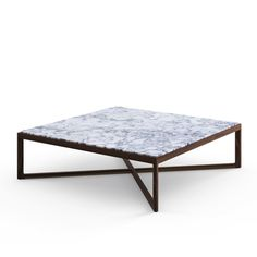 This marble Square Coffee Table by Knoll has a subtle elegance that harmonizes with any setting.
