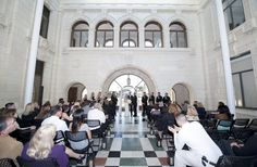 Photo of San Buenaventura City Hall - Ventura, CA, United States. Our wedding ceremony inside the atrium at City Hall. Beautiful architecture, natural light and marble floors!