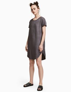 Check this out! Short dress in washed, woven viscose fabric with a round neck, short sleeves with sewn cuffs, and a rounded hem. Slightly longer at back. - Visit hm.com to see more.