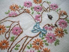 This reminds me of an embroidered pillow my mom made for us when we were babies.
