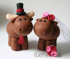 Moose Wedding Cake Toppers. (Other Animals available via Etsy).  $67.00.    This listing is for a custom handmade Moose Wedding Cake Topper. You can decide on the details and accents colors.    The Moose are about 2.3 inches high from head to toe and completely handmade out of strong quality non toxic polymer clay that will last a lifetime.