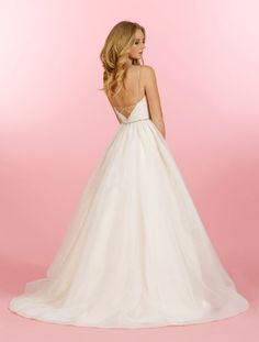 Style 1453 > Bridal Gowns, Wedding Dresses > Blush by Hayley Paige > Shown Blush & Ivory Organza Ball gown with Two Tone Crossover bodice & V-neckline. Pink & Alabaster Opalescent Belt at waist & Crisscross strap detail at back (back)