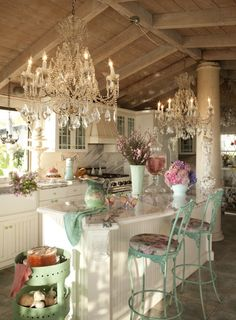 kitchen with twin crystal chandelier & aqua painted wrought iron barstools