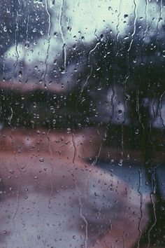 Raindrops on the window. Travelling in the rain. Being warm and cosy listening to rain fall. Bliss.