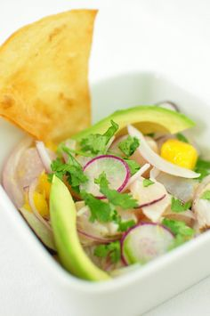 Snapper Ceviche - radish & mango.  Very good.  Notes:  season fish well with salt and pepper, use a larger size Serrano for a little more heat. Follow recipe and fry your own chips!!!