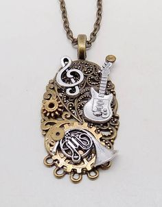Steampunk jewelry Steampunk guitar and angel wing necklace