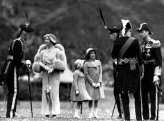 Queen Elizabeth talking to Lord Elphinstone,  King George VI on the right; Princesses Elizabeth and Margaret Rose in centre, 1937