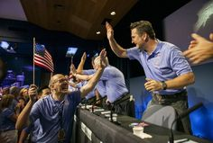 Curiosity team members celebrate at NASA's Jet Propulsion Laboratory in Pasadena, California, after the successful landing of the Curiosity rover on Mars.